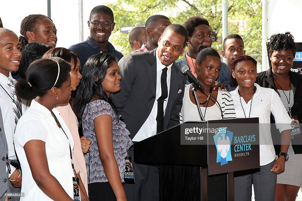 Brooklyn Nets co-owner Shawn Carter brings onstage high school students at George Westinghouse Career and Technical Education High School, his alma mater, at the Barclays Center press conference at Atlantic Terminal on September 26, 2011 in the Brooklyn borough of New York City.