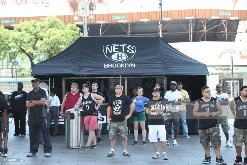 Brooklyn Nets fans look on outside the arena during a press conference at the Barclays Center on July 18, 2013 in the Brooklyn borough of New York City.