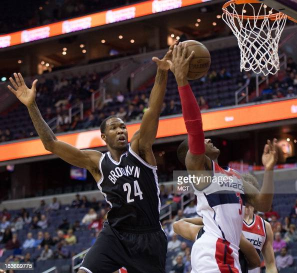 Brooklyn Nets forward Chris Johnson blocks the shot of Washington Wizards shooting guard Bradley Beal during the second half of their preseason game...