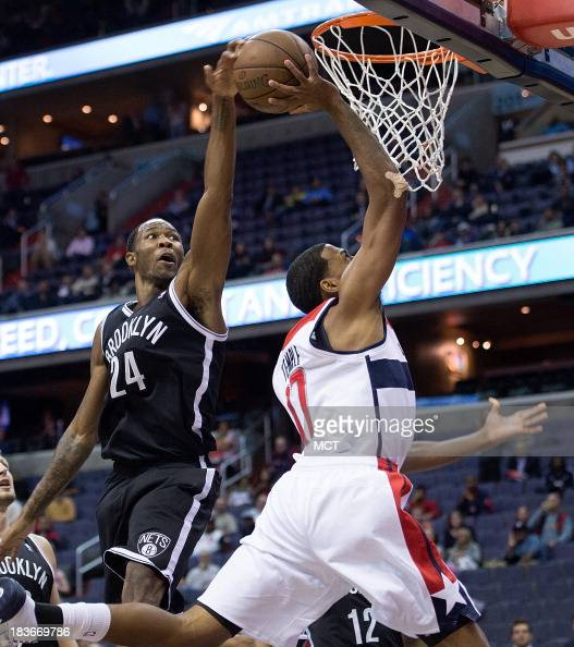Brooklyn Nets forward Chris Johnson blocks the shot of Washington Wizards shooting guard Garrett Temple in the closing seconds of regulation play...