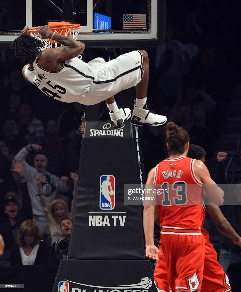 Brooklyn Nets Gerald Wallace dunks over Chicago Bulls Joakim Noah during Game 7 of the Eastern Conference quarterfinals at the Barclays Center on May 4 , 2013 in the Brooklyn borough of New York City. AFP PHOTO / STAN HONDA