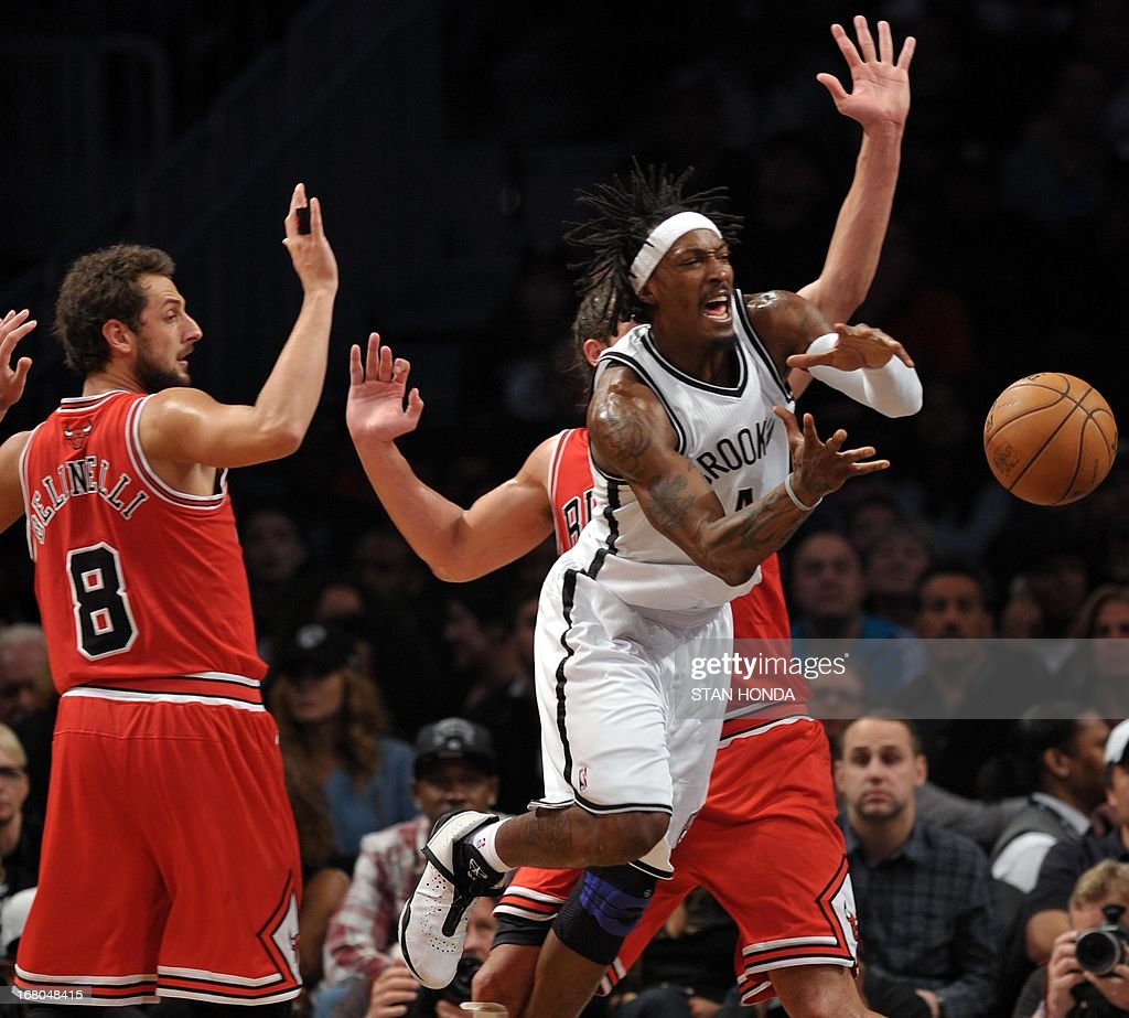 Brooklyn Nets Gerald Wallace passes against Chicago Bulls Marco Belinelli during Game 7 of the Eastern Conference quarterfinals at the Barclays Center on May 4 , 2013 in the Brooklyn borough of New York City. AFP PHOTO / STAN HONDA
