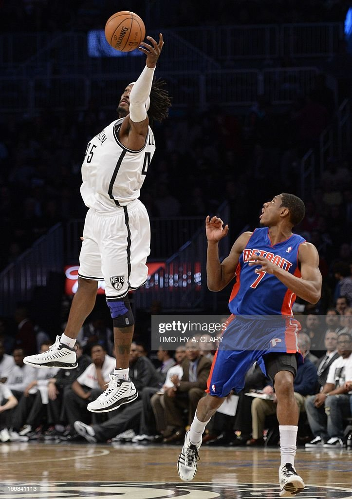 Brooklyn Nets Gerald Willaims (L) snares a rebound before Detroit Pistons Brandon Knight during their NBA game at the Barclays Center on April 17, 2013 in the Brooklyn borough of New York City. AFP PHOTO / TIMOTHY A. CLARY