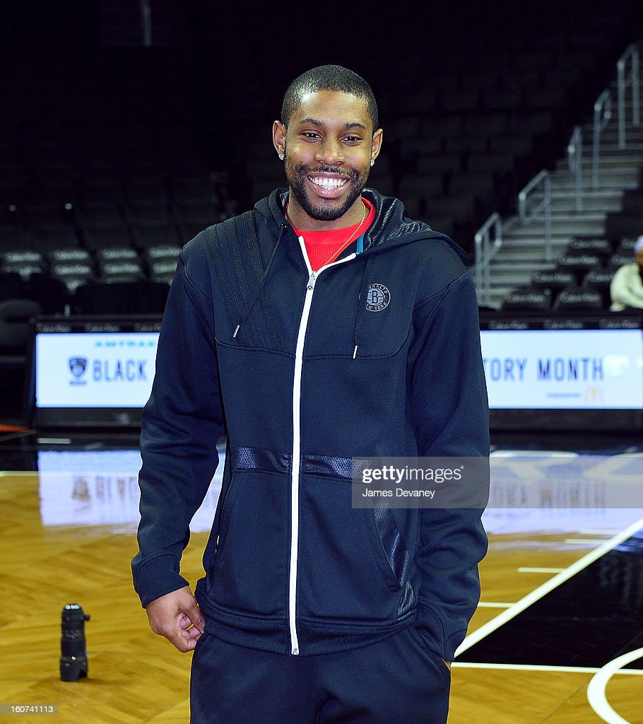Brooklyn Nets guard <a gi-track='captionPersonalityLinkClicked' href=/galleries/search?phrase=C.J.+Watson&family=editorial&specificpeople=740190 ng-click='$event.stopPropagation()'>C.J. Watson</a> meets with 30 4th and 5th grade students from P.S. 282 in Park Slope to honor the legacy of Brooklyn's African-American basketball history through the installation of six large-scale photographs of the Black Fives at Barclays Center on February 4, 2013 in the Brooklyn borough of New York City.