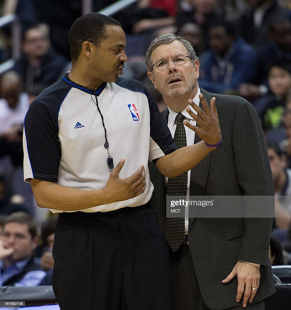 Brooklyn Nets Head Coach P. J. Carlesimo gets an explanation on a call from referee James Capers (19) during the first half of their game played at the Verizon Center in Washington, D.C., Friday, February 8, 2013.