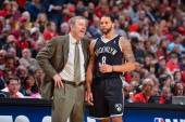 Brooklyn Nets Interim Head Coach PJ Carlesimo speaks with Deron Williams while playing against the Chicago Bulls in Game Three of the Eastern...