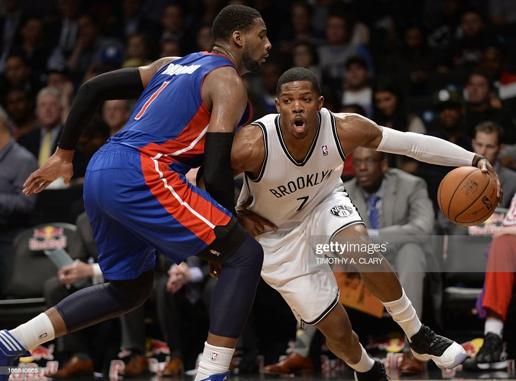 Brooklyn Nets Joe Johnson (R) drives against Detroit Pistons Andre Drummond (L) during their NBA game at the Barclays Center on April 17, 2013 in the Brooklyn borough of New York City.