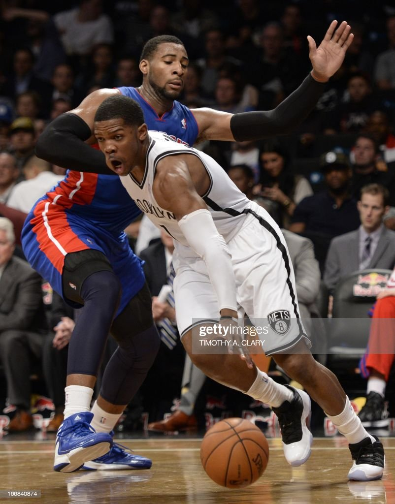 Brooklyn Nets Joe Johnson (R) drives against Detroit Pistons Andre Drummond (L) during their NBA game at the Barclays Center on April 17, 2013 in the Brooklyn borough of New York City. AFP PHOTO / TIMOTHY A. CLARY