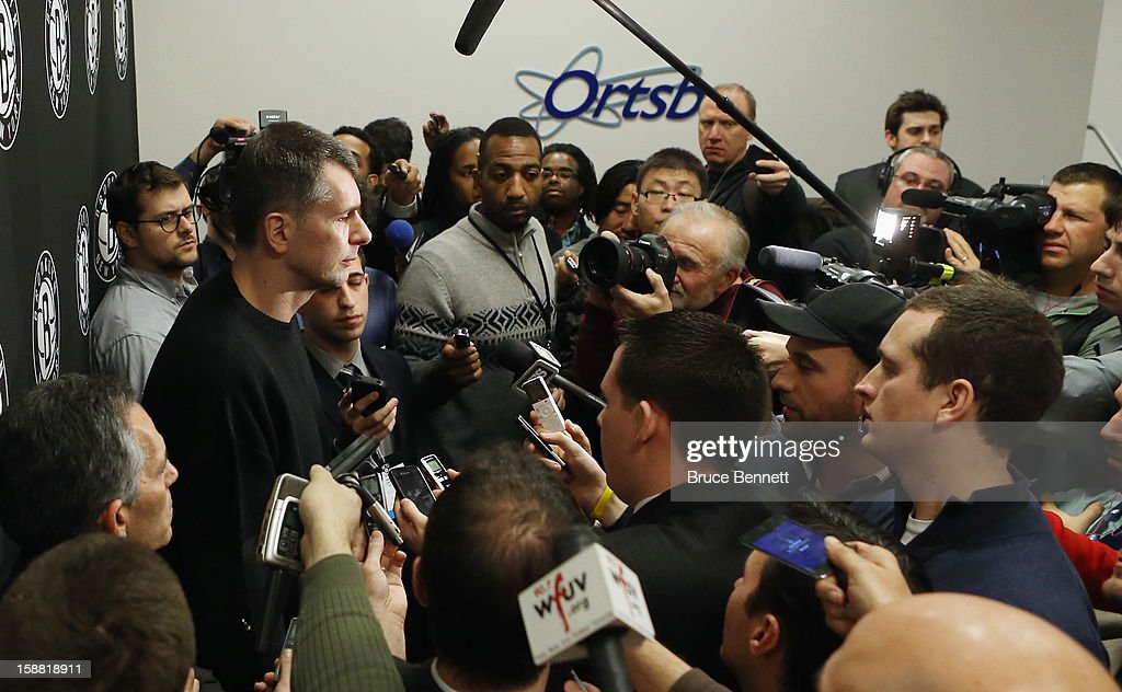 Brooklyn Nets owner <a gi-track='captionPersonalityLinkClicked' href=/galleries/search?phrase=Mikhail+Prokhorov&family=editorial&specificpeople=4102603 ng-click='$event.stopPropagation()'>Mikhail Prokhorov</a> addresses the media regarding the firing of Avery Johnson at halftime of the game between the Nets and the Charlotte Bobcats at the Barclays Center on December 28, 2012 in the Brooklyn borough of New York City.