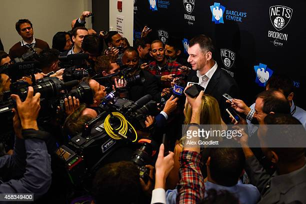 Brooklyn Nets owner Mikhail Prokhorov speaks to the media before a game between the Brooklyn Nets and Oklahoma City Thunder at the Barclays Center on...