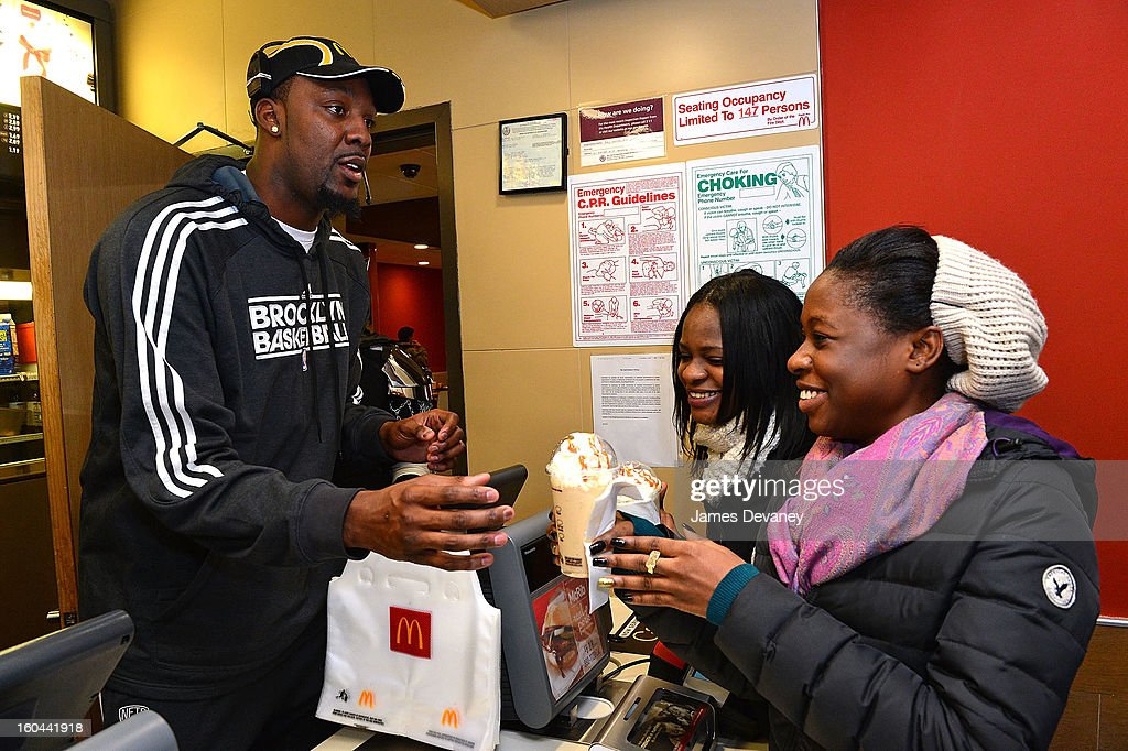 Brooklyn Nets player <a gi-track='captionPersonalityLinkClicked' href=/galleries/search?phrase=Andray+Blatche&family=editorial&specificpeople=4282797 ng-click='$event.stopPropagation()'>Andray Blatche</a> participates in the 'Random Acts of Kindness' program by serving McDonald's customers in the Prospect Lefferts Gardens neighborhood of Brooklyn on January 31, 2013 in New York City.