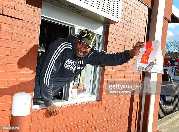 Brooklyn Nets player Andray Blatche participates in the 'Random Acts of Kindness' program by serving McDonald's customers in the Prospect Lefferts...