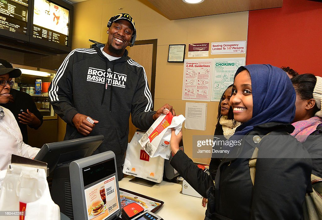 Brooklyn Nets player Andray Blatche participates in the 'Random Acts of Kindness' program by serving McDonald's customers in the Prospect Lefferts Gardens neighborhood of Brooklyn on January 31, 2013 in New York City.