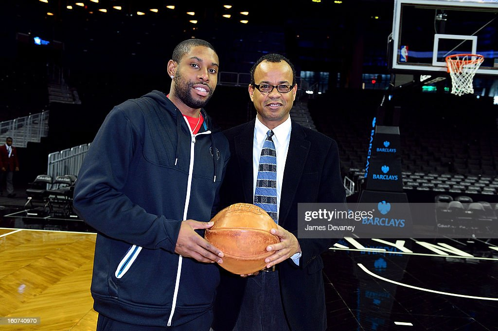 Brooklyn Nets player <a gi-track='captionPersonalityLinkClicked' href=/galleries/search?phrase=C.J.+Watson&family=editorial&specificpeople=740190 ng-click='$event.stopPropagation()'>C.J. Watson</a> and Black Fives Foundation founder Claude Johnson honor Legacy Of The Historic African-American Basketball League at Barclays Center on February 4, 2013 in the Brooklyn borough of New York City.
