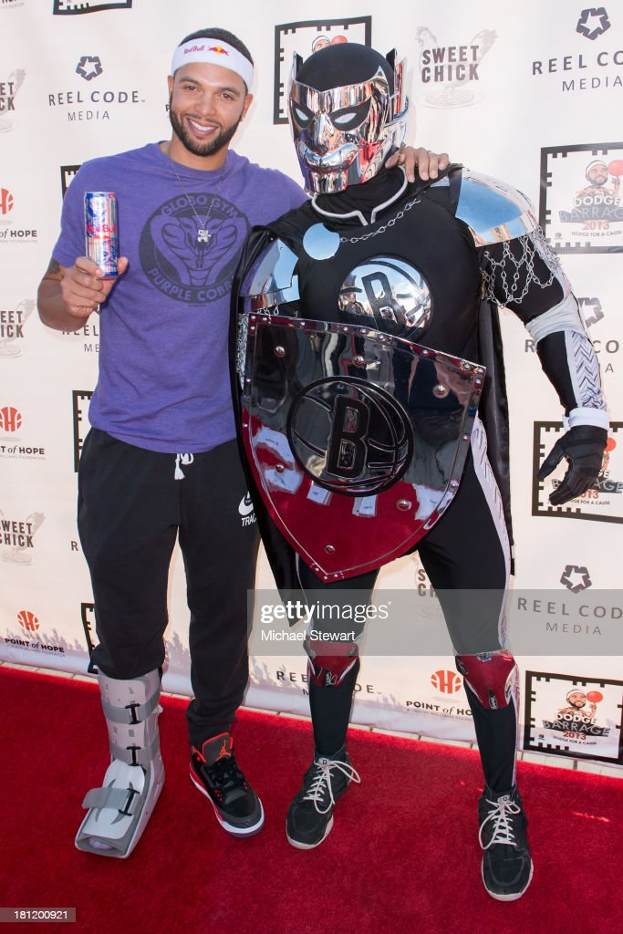 Brooklyn Nets player Deron Williams (L) and the BrooklyKnight attend Dodge Barrage 2013 at Pier 36 on September 19, 2013 in New York City.