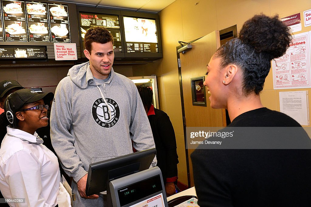 Brooklyn Nets player <a gi-track='captionPersonalityLinkClicked' href=/galleries/search?phrase=Kris+Humphries&family=editorial&specificpeople=209199 ng-click='$event.stopPropagation()'>Kris Humphries</a> participates in the 'Random Acts of Kindness' program by serving McDonald's customers in the Prospect Lefferts Gardens neighborhood of Brooklyn on January 31, 2013 in New York City.