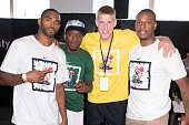 Brooklyn Nets players Alan Anderson Tyshawn Taylor Mason Plumlee and Paul Pierce attend Dodge Barrage 2013 at Pier 36 on September 19 2013 in New...