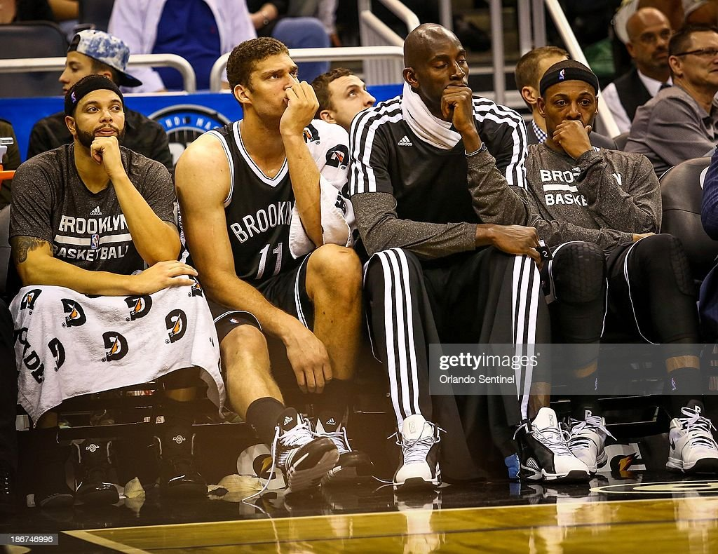 Brooklyn Nets players Deron Williams (8), Brook Lopez (11), Kevin Garnett (2), and Paul Pierce (34) react as the are defeated by the Orlando Magic, 107-86, at the Amway Center in Orlando, Flornida, Sunday, November 3, 2013.