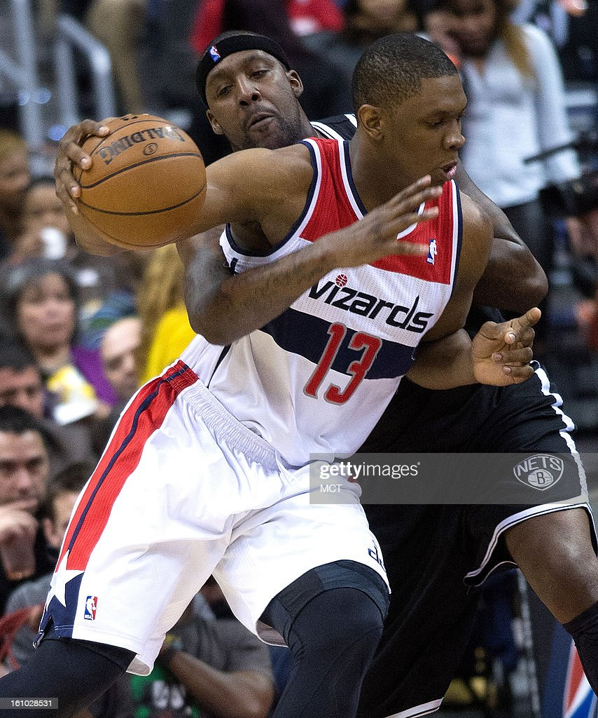 Brooklyn Nets power forward Andray Blatche (0) tries the polk the ball away from Washington Wizards power forward Kevin Seraphin (13) during the first half of their game played at the Verizon Center in Washington, D.C., Friday, February 8, 2013.