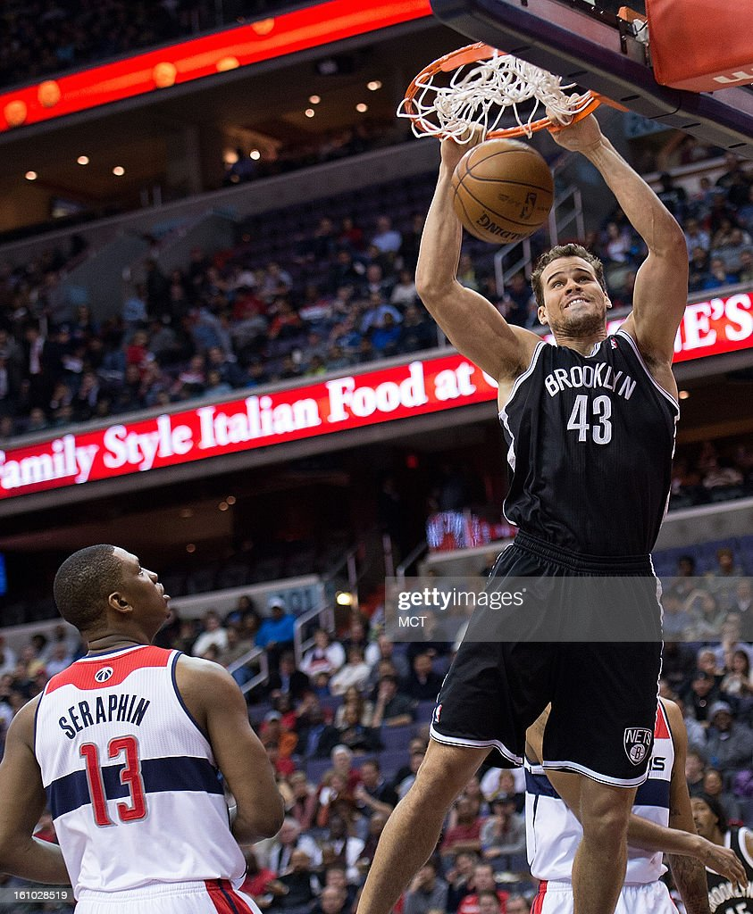 Brooklyn Nets power forward Kris Humphries (43) slam dunks over Washington Wizards power forward Kevin Seraphin (13) during the first half of their game played at the Verizon Center in Washington, D.C., Friday, February 8, 2013.