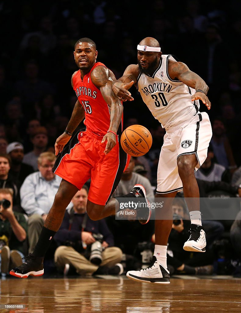 Brooklyn Nets power forward Reggie Evans #30 and Toronto Raptors power forward Amir Johnson #15 fight for a rebound during their game at the Barclays Center on January15, 2013 in the Brooklyn borough of New York City.