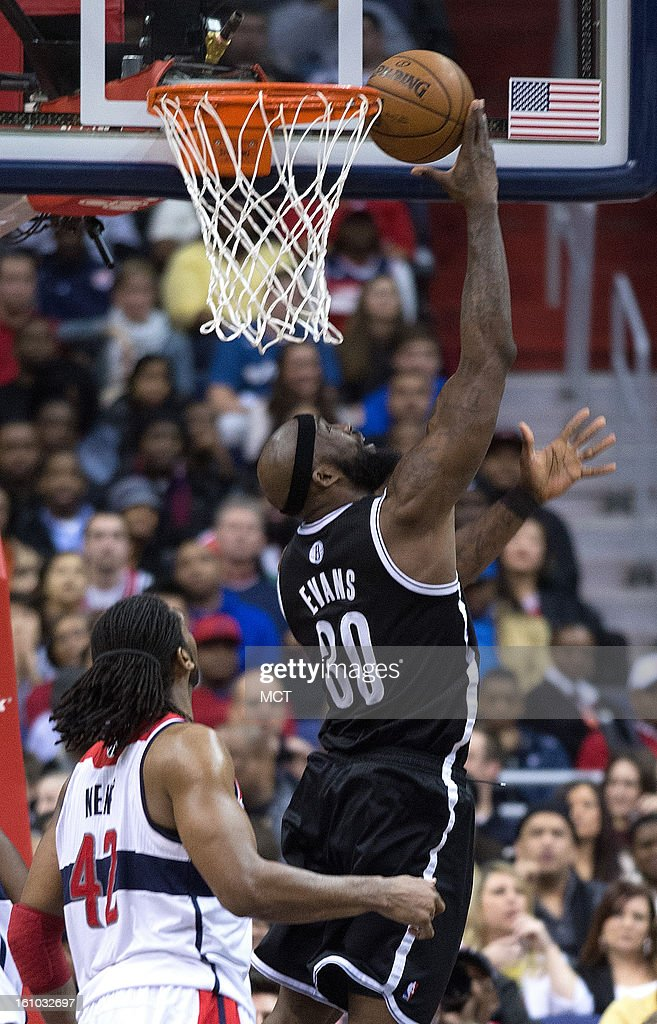 Brooklyn Nets power forward Reggie Evans (30) scores on a reverse layup over Washington Wizards center Nene (42) during the second half of their game played at the Verizon Center in Washington, D.C., Friday, February 8, 2013. Washington defeated Brooklyn 89-74.