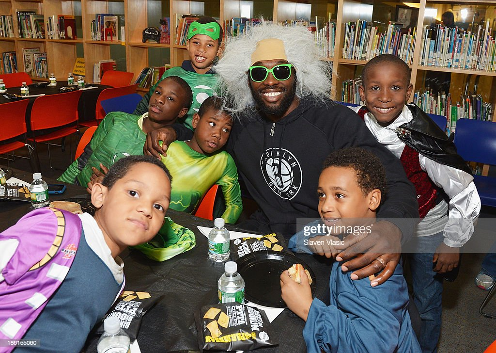 Brooklyn Nets' <a gi-track='captionPersonalityLinkClicked' href=/galleries/search?phrase=Reggie+Evans&family=editorial&specificpeople=202254 ng-click='$event.stopPropagation()'>Reggie Evans</a> hosts a Halloween Monster Mash for 50 kids at The Brooklyn Children's Museum on October 28, 2013 in New York City.