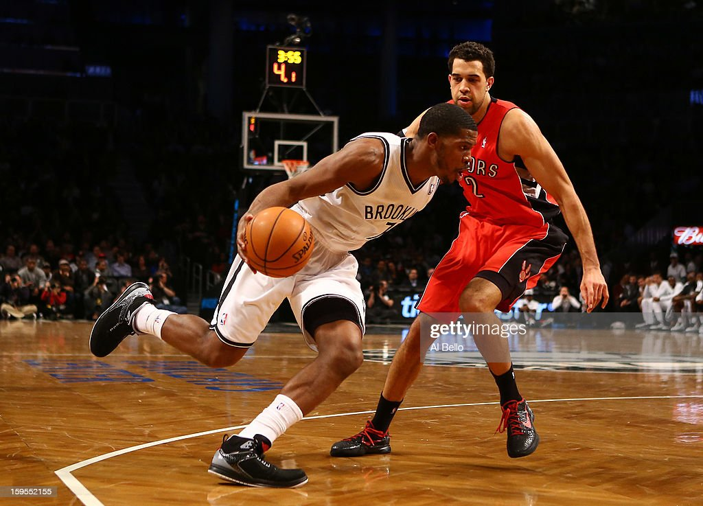 Brooklyn Nets shooting guard <a gi-track='captionPersonalityLinkClicked' href=/galleries/search?phrase=Joe+Johnson+-+Basketball+Player&family=editorial&specificpeople=201652 ng-click='$event.stopPropagation()'>Joe Johnson</a> #7 drives against Toronto Raptors small forward <a gi-track='captionPersonalityLinkClicked' href=/galleries/search?phrase=Landry+Fields&family=editorial&specificpeople=4184645 ng-click='$event.stopPropagation()'>Landry Fields</a> #2 during their game at the Barclays Center on January15, 2013 in the Brooklyn borough of New York City.