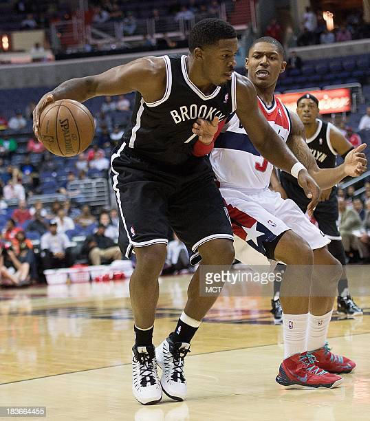 Brooklyn Nets shooting guard Joe Johnson is guarded by Washington Wizards shooting guard Bradley Beal during the first half of their preseason game...