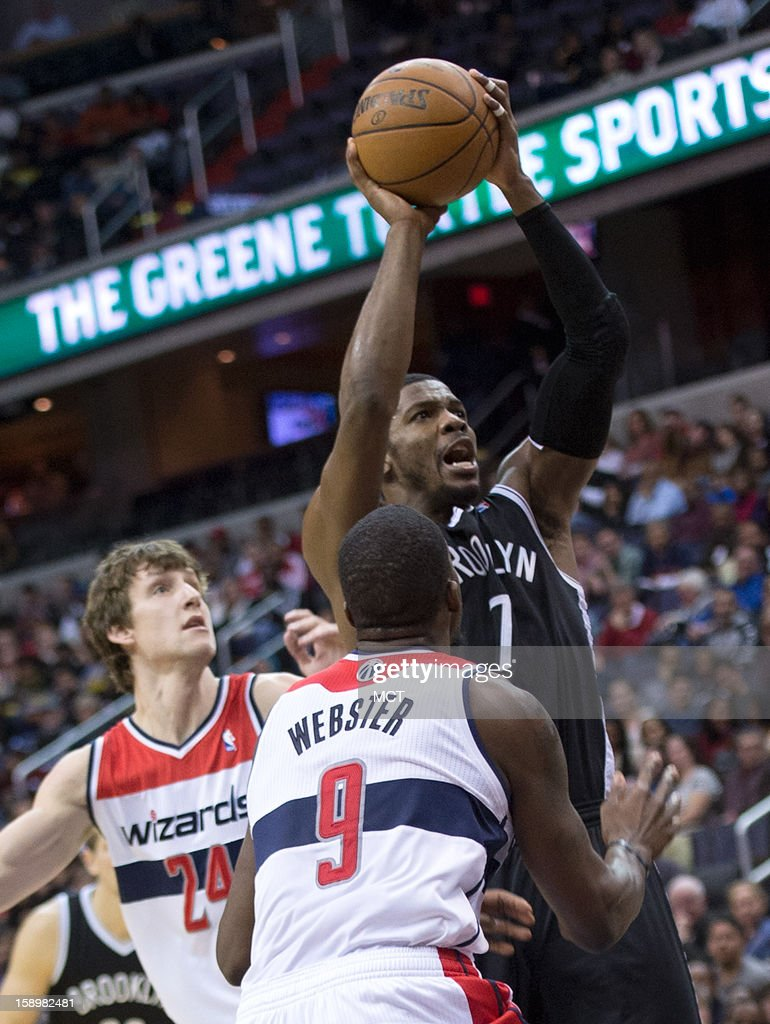 Brooklyn Nets shooting guard Joe Johnson (7) shoots over Washington Wizards small forward Martell Webster (9) during the first half of their game played at the Verizon Center in Washington, D.C., Friday, January 4, 2013.