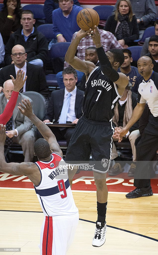 Brooklyn Nets shooting guard Joe Johnson (7) shoots the game-winning shot over Washington Wizards small forward Martell Webster (9) during double-overtime of their game played at the Verizon Center in Washington, D.C., Friday, January 4, 2013. Brooklyn defeated Washington 115-113.