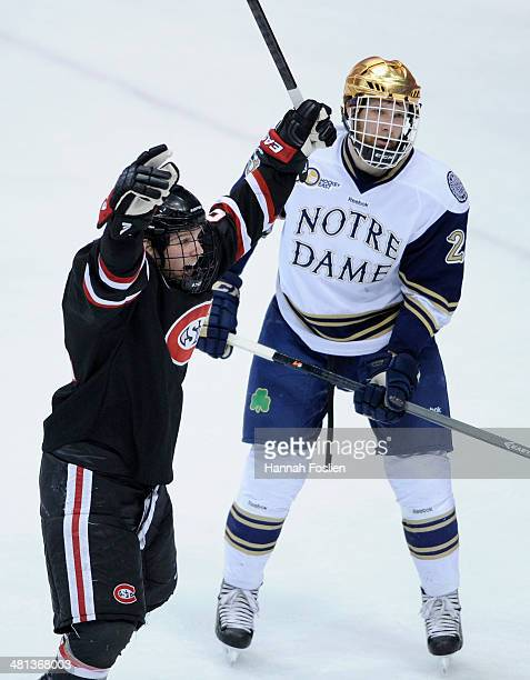 Brooks Bertsch of the St Cloud State Huskies celebrates scoring a goal as Johnson Eric of the Notre Dame Fighting Irish looks on during the first...