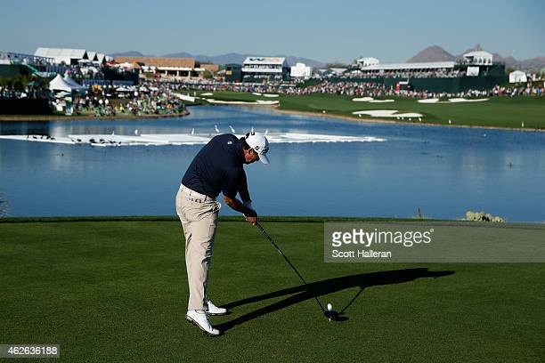 Brooks Koepka hits a tee shot on the 18th hole during the fourth round of the Waste Management Phoenix Open at TPC Scottsdale on February 1 2015 in...