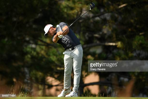 Brooks Koepka hits his tee shot on the fourth hole during the first round of the BMW Championship at Conway Farms Golf Club on September 14 2017 in...