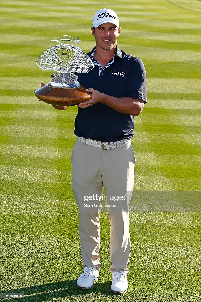 Brooks Koepka holds the trophy after winning the Waste Management Phoenix Open at TPC Scottsdale on February 1, 2015 in Scottsdale, Arizona.