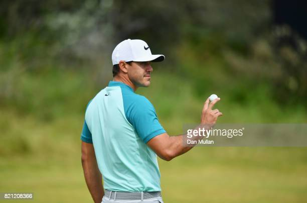 Brooks Koepka of the United States acknowledges the crowd on the 5th hole during the final round of the 146th Open Championship at Royal Birkdale on...