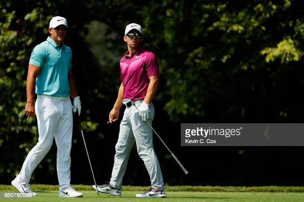 Brooks Koepka of the United States and Paul Casey of England look on from the second tee during the first round of the TOUR Championship at East Lake...