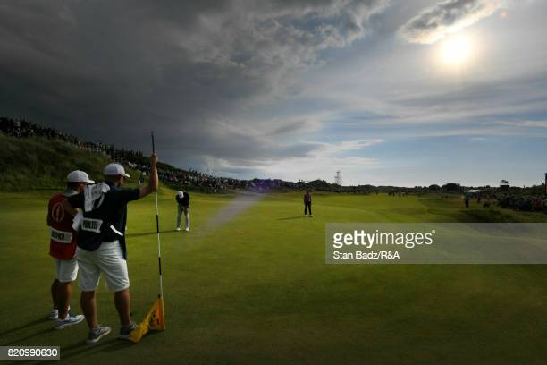 Brooks Koepka of the United States hits a putt 13th hole during the third round of the 146th Open Championship at Royal Birkdale on July 22 2017 in...