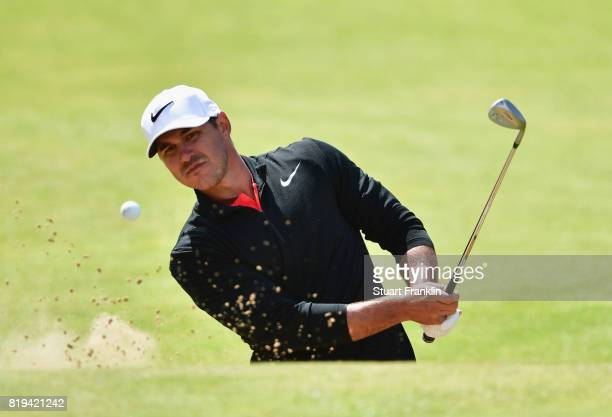 Brooks Koepka of the United States hits a shot from the bunker during the first round of the 146th Open Championship at Royal Birkdale on July 20...