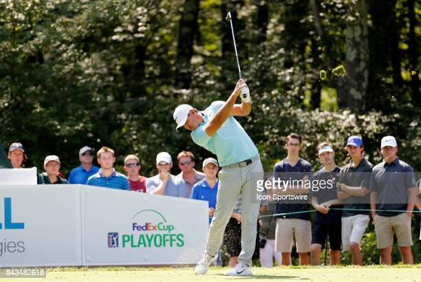 Brooks Koepka of the United States hits from the 8th tee during the final round of the Dell Technologies Championship on September 4 at TPC Boston in...