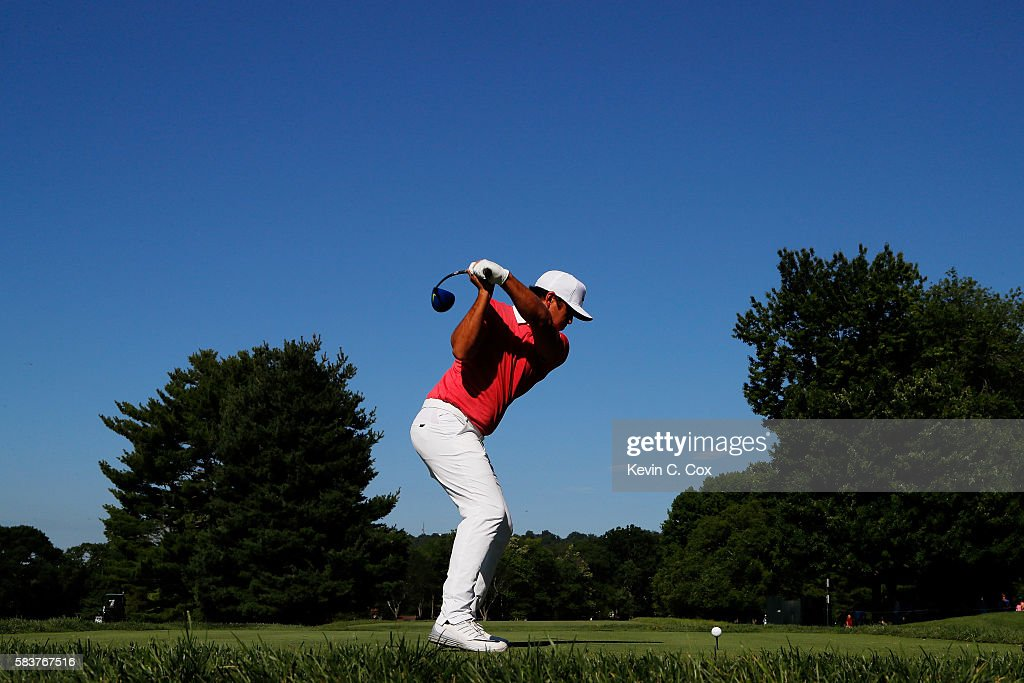 Brooks Koepka of the United States hits his tee shot on the 13th hole during a practice round prior to the 2016 PGA Championship at Baltusrol Golf...