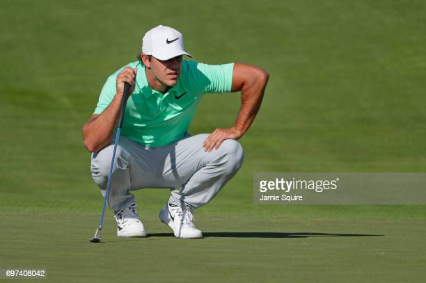 Brooks Koepka of the United States lines up a putt on the 12th green during the final round of the 2017 US Open at Erin Hills on June 18 2017 in...