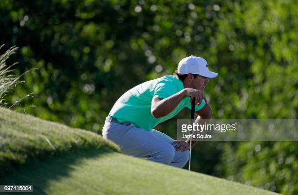 Brooks Koepka of the United States lines up a putt on the 15th green during the final round of the 2017 US Open at Erin Hills on June 18 2017 in...