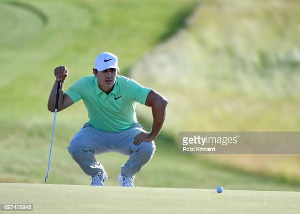 Brooks Koepka of the United States lines up a putt on the 18th green during the final round of the 2017 US Open at Erin Hills on June 18 2017 in...