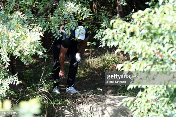 Brooks Koepka of the United States locates his ball on the eighth hole during the third round of the WGC HSBC Champions at Sheshan International Golf...
