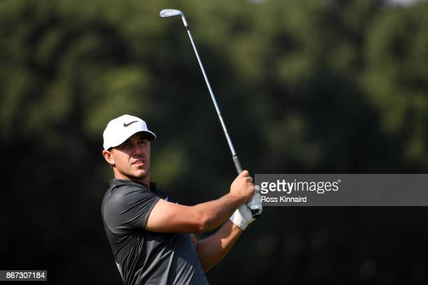 Brooks Koepka of the United States plays a shot during the third round of the WGC HSBC Champions at Sheshan International Golf Club on October 28...