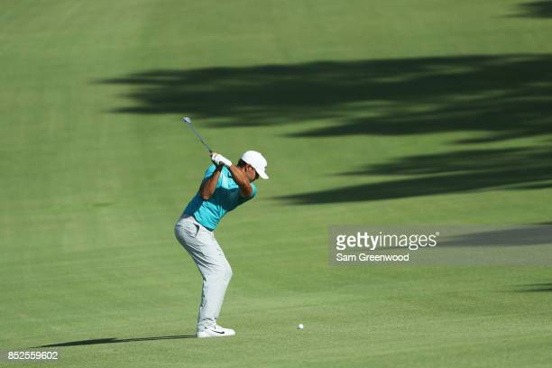 Brooks Koepka of the United States plays a shot on the 14th hole during the third round of the TOUR Championship at East Lake Golf Club on September...