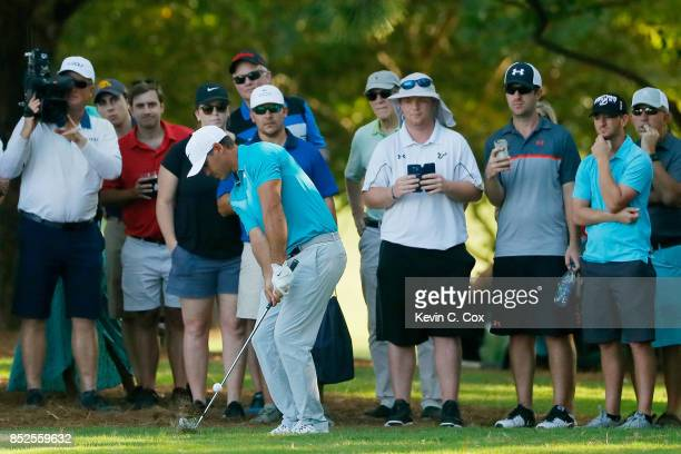 Brooks Koepka of the United States plays a shot on the 17th hole during the third round of the TOUR Championship at East Lake Golf Club on September...