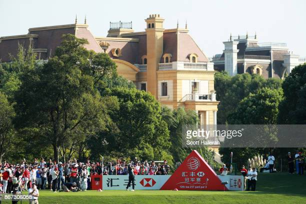 Brooks Koepka of the United States plays his shot from the 12th tee during the third round of the WGC HSBC Champions at Sheshan International Golf...