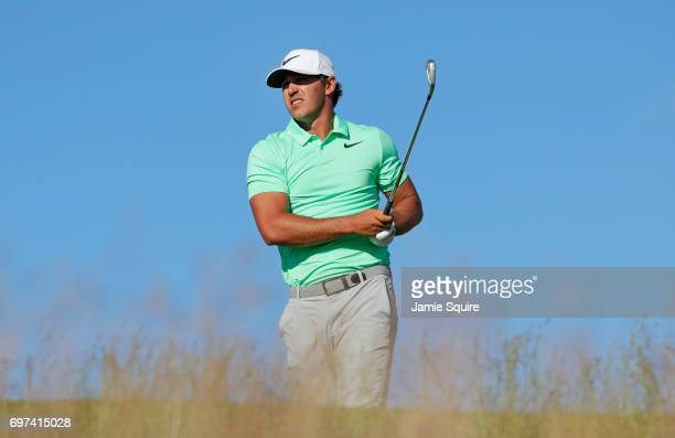 Brooks Koepka of the United States plays his shot from the 15th tee during the final round of the 2017 US Open at Erin Hills on June 18 2017 in...